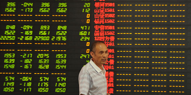 FUYANG, CHINA - JULY 08: (CHINA OUT) An investor observes stock market at a stock exchange hall on July 8, 2015 in Fuyang, Anhui Province of China. Chinese shares dropped sharply on Wednesday with Shanghai Composite Index slipping down to nearly 3,400 points when it opened, the lowest point on that day. It's said that more than 1,700 stocks of Chinese companies in Shanghai Stock Exchange and Shenzhen Stock Exchange reached to decline limit. (Photo by ChinaFotoPress/Getty Images)