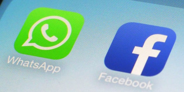 FILE - This Feb. 19, 2014 file photo shows WhatsApp and Facebook app icons on a smartphone in New York. One sign of the growing confidence in the US economy was an increase in corporate deals. One of the most high-profile was Facebook's $22 billion acquisition of the mobile-messaging application WhatsApp. (AP Photo/Patrick Sison, File)