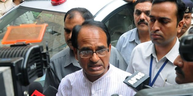 Indian Chief Minister of the state of Madhya Pradesh Shivraj Singh Chauhan talks to media outside the Ministry of External Affairs in New Delhi on July 8, 2015. The embattled chief minister of India's Madhya Pradesh state July 7, 2015 asked federal investigators to carry out an independent probe into a jobs scandal after a spate of deaths which opponents have linked to the scam. Nearly 2,000 people have been arrested since 2013 over the so-called Vyapam scandal in which thousands of people are alleged to have paid bribes in return for jobs on the state payroll or for places in educational institutes. AFP PHOTO / STR        (Photo credit should read STRDEL/AFP/Getty Images)