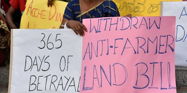 Activists stage a protest against Prime Minister Narendra Modi's government in Bangalore on June 6, 2015.  Modi was put on the defensive last month by the suicide of a farmer at a rally in New Delhi against the land bill, a death seized on by opponents as an example of his administration's insensitivity towards those on the land. AFP PHOTO/Manjunath KIRAN        (Photo credit should read MANJUNATH KIRAN/AFP/Getty Images)