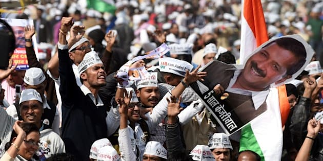 Supporters of the Aam Aadmi Party (AAP) shout slogans as they watch leader Arvind Kejriwal being sworn in as Delhi chief minister by Delhi Lieutenant Governor Najeeb Jung during the ceremony at Ramlila Grounds in New Delhi on February 14, 2015. Arvind Kejriwal promised to makeDelhiIndia's first corruption-free state and end what he called its 'VIP culture' as he was sworn in as chief minister before a huge crowd of cheering supporters.  AFP PHOTO / SAJJAD HUSSAIN        (Photo credit should read SAJJAD HUSSAIN/AFP/Getty Images)