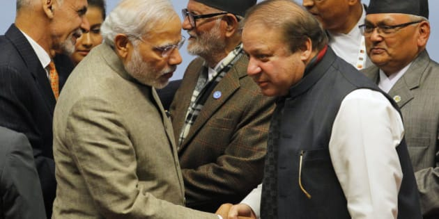 Pakistani Prime Minister Nawaz Sharif, right, moves closer to listen to Indian Prime Minister Narendra Modi as they shake hands during closing ceremony of the 18th summit of the South Asian Association for Regional Cooperation (SAARC) in Katmandu, Nepal, Thursday, Nov. 27, 2014. South Asian heads of state attending their first summit in three years reached a deal on energy sharing Thursday, but failed on two other economic agreements during a retreat where Indian and Pakistan leaders shook hands. (AP Photo/Niranjan Shrestha, Pool)
