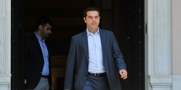 Greece's Prime Minister Alexis Tsipras leaves Maximos Mansion in Athens, Thursday, July 9, 2015. Greece's government was racing Thursday to finalize a plan of reforms for its third bailout, hoping this time the proposal will meet with approval from its European partners and stave off a potentially catastrophic exit from Europe's joint currency, the euro, within days. (Giannis Kotsiaris/InTime News via AP)  GREECE OUT