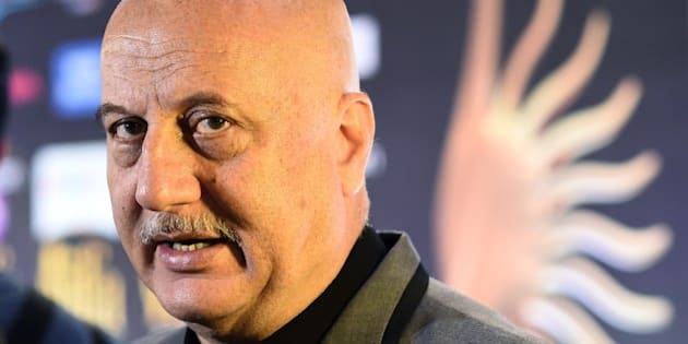 Bollywood actor Anupam Kher speaks to the media on the green carpet at the Tampa Convention Center ahead of IIFA Rocks on the second day of the 15th International Indian Film Academy (IIFA) Awards in Tampa, Florida, April 24, 2014. AFP PHOTO JEWEL SAMAD        (Photo credit should read JEWEL SAMAD/AFP/Getty Images)