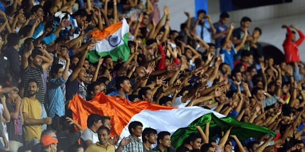 India's fans cheer after their team scored a goal during the Asia Group D FIFA World Cup 2018 qualifying football match between India and Oman at Kanteerawa Stadium in Bangalore on June 11, 2015. AFP PHOTO / MANJUNATH KIRAN        (Photo credit should read MANJUNATH KIRAN/AFP/Getty Images)