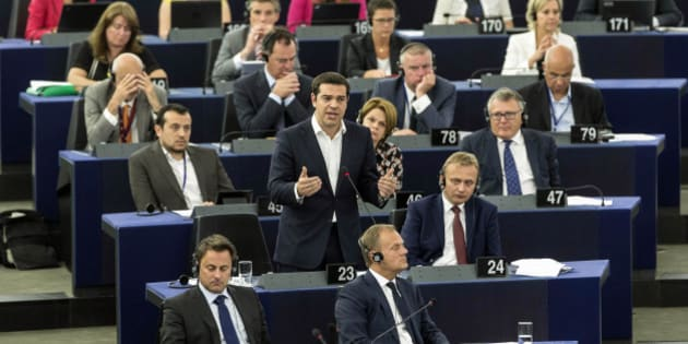 Greek Prime Minister Alexis Tsipras, standing at center, delivers hi speech at the European Parliament in Strasbourg, eastern France, Wednesday, July 8, 2015.  Tsipras earned both cheers and jeers as he addressed lawmakers at the European Parliament, where he said his country is seeking a deal that might bring a definitive end to his country's financial crisis, not just a temporary stop-gap.(AP Photo/Jean-Francois Badias)