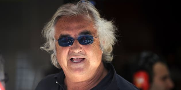 Former Renault F1 team principal Flavio Briatore is pictured in the paddock of the Autodromo Nazionale circuit on September 11, 2010 in Monza, after the qualifying session of the Formula One Italian Grand Prix.             AFP PHOTO / FRED DUFOUR (Photo credit should read FRED DUFOUR/AFP/Getty Images)