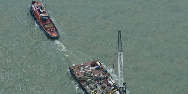 The wreck of the German World War II Dornier Do-17 plane is transported on a barge to harbour near Ramsgate on June 11, 2013 following a salvage operation that raised it from the sea bed.   A British salvage team pulled off a painstaking operation to lift a German World War II bomber plane from its grave off the coast of southeast England. Covered with barnacles and missing a wing, the dripping wreck of the Dornier Do-17 plane was slowly raised to the surface at Goodwin Sands, Kent, at the mouth of the English Channel.  AFP PHOTO/WILL OLIVER        (Photo credit should read WILL OLIVER/AFP/Getty Images)