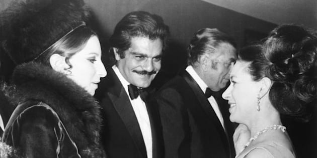 """FILE - In this Jan. 15, 1969 file photo, Britain's Princess Margaret, right, talks with American singer Barbra Streisand, left, and actor Omar Sharif, center, at the premiere of the film """"Funny Girl,"""" at the Odeon Cinema, London. Sharif has died in a Cairo hospital of a heart attack, his agent said on Friday, July 10, 2015. (AP Photo, File)"""