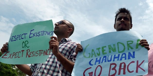 Indian students of The Satyajit Ray Film and Television Institute (SRFTI) shout slogans against the central government as they hold placards during a protest rally in Kolkata on June 16, 2015, held in support of fellow cinema students at the  Film and Television Institute of India in Pune, who are showing their opposition to the appointment of Gajendra Chauhan as their president, by not attending classes. AFP PHOTO/Dibyangshu SARKAR        (Photo credit should read DIBYANGSHU SARKAR/AFP/Getty Images)