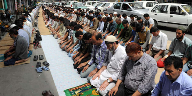 Kashmiri Muslims perform congregational prayers on a street during the first day of the fasting month of Ramadan in Srinagar on July 21, 2012. Muslims fasting in the month of Ramadan must abstain from food, drink and sex from dawn until sunset, when they break the fast with the meal known as Iftar. AFP PHOTO/Rouf BHAT        (Photo credit should read ROUF BHAT/AFP/GettyImages)