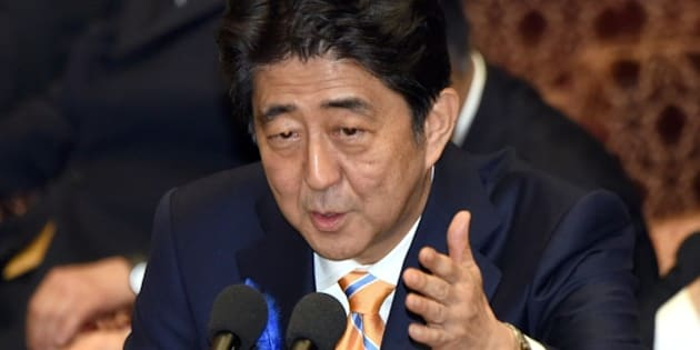 Japan's Prime Minister Shinzo Abe gestures as he answers questions from a parliament member at a committee of the lower house to discuss controversial security bills aimed at beefing up the military in Tokyo on July 10, 2015.  Abe, a robust nationalist, has pushed for what he calls a normalisation of Japan's military posture and has sought to loosen restrictions that have bound the so-called Self-Defense Forces to a narrowly defensive role for decades.     AFP PHOTO / Toru YAMANAKA        (Photo credit should read TORU YAMANAKA/AFP/Getty Images)