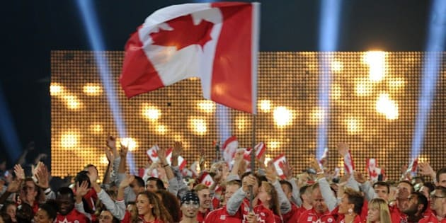 The delegation from Canada arrives during the opening ceremony for the 2015 Pan American Games at the Rogers Centre in Toronto, Ontario, on July 10, 2015. AFP PHOTO / HECTOR RETAMAL        (Photo credit should read HECTOR RETAMAL/AFP/Getty Images)