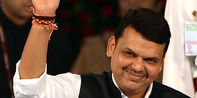 India's Maharashtra state new Chief Minister and BJP leader Devendra Fadnavis waves towards crowd after his swearing-in ceremony in Mumbai on October 31, 2014. India's ruling Bharatiya Janata Party (BJP) snatched election victory on October 19 in two key Indian states, tightening its grip on power after storming to government nationally five months ago.  AFP PHOTO/ PUNIT PARANJPE        (Photo credit should read PUNIT PARANJPE/AFP/Getty Images)