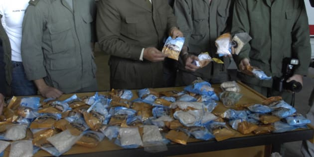 Lebanese customs officers display confiscated drugs of Captagon pills found in a bus, at Beirut Port, in Lebanon, Monday, Nov. 26, 2007. Lebanese customs authorities on Monday confiscated more than two million smuggled tranquilizer pills that were brought from Syria and were to be sent to the wealthy Gulf state of Qatar through Lebanon, state-run National News Agency and security officials said.(AP Photo/Ahmad Omar)