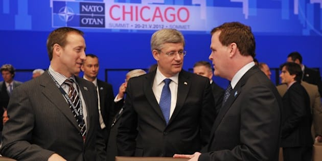 Canadian Prime Minister Stephen Harper (C) speaks with Canadian Defence Minister Peter Mackay (L) and Canadian Foreign Minister John Baird (R) at the International Security Assistance Force ISAF meeting on Afghanistan during the 2012 NATO Summit May 21, 2012 at the McCormick Place convention center in Chicago. AFP PHOTO/Mandel NGAN
