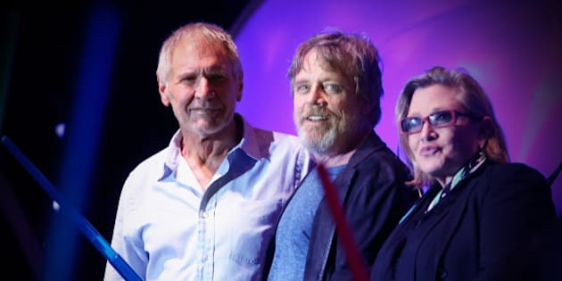 SAN DIEGO, CA - JULY 10: (EDITORS NOTE: This image was processed using digital filters.) (L-R) Actors Harrison Ford, Mark Hamill, Carrie Fisher and more than 6000 fans enjoyed a surprise 'Star Wars' Fan Concert performed by the San Diego Symphony, featuring the classic 'Star Wars' music of composer John Williams, at the Embarcadero Marina Park South on July 10, 2015 in San Diego, California.  (Photo by Jesse Grant/Getty Images for Disney)