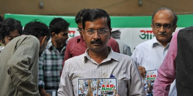 Aam Aadmi Party (AAP),or Common Man Party, chief Arvind Kejriwal releases the party's manifesto ahead of the general elections in New Delhi, India, Thursday, April, 3, 2014. India will hold national elections from April 7 to May 12, kicking off a vote that many observers see as the most important election in more than 30 years in the world's largest democracy. (AP Photo/Tsering Topgyal)