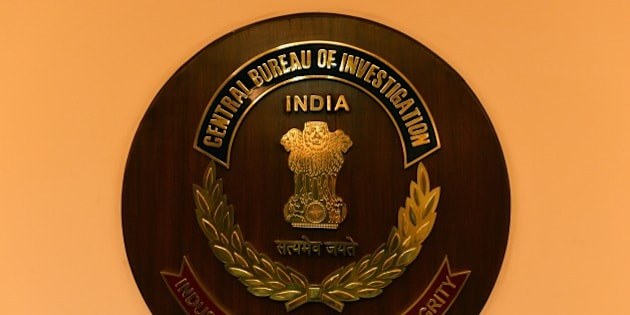 The logo of India's Central Bureau of Investigation (CBI) is seen during a press conference by newly-elected CBI director Anil Kumar Sinha in New Delhi on December 3, 2014. The CBI is an Indian governmental agency that jointly serves as a criminal investigation body, national security agency and intelligence agency. AFP PHOTO / CHANDAN KHANNA        (Photo credit should read Chandan Khanna/AFP/Getty Images)