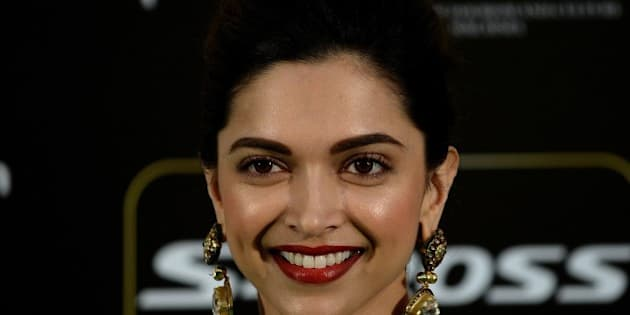 Bollywood actress Deepika Padukone poses on the green carpet as she arrives to attend the final day of the 16th International Indian Film Academy (IIFA) Awards at the Putra Stadium in Kuala Lumpur on June 7, 2015.   AFP PHOTO / MANAN VATSYAYANA        (Photo credit should read MANAN VATSYAYANA/AFP/Getty Images)