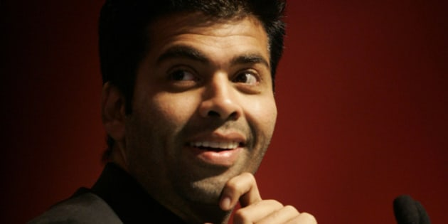 Bollywood film maker Karan Johar gestures as he participates in a conclave of leaders organized by an Indian media group, in New Delhi, India, Saturday, March 7, 2009. (AP Photo/Gemunu Amarasinghe)