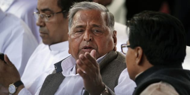 Samajwadi Party President Mulayam Singh Yadav attends the oath taking ceremony of his son Akhilesh Yadav as the Chief Minister of Uttar Pradesh state in Lucknow, India, Thursday, March 15, 2012. Yadav, 38, who played a major role in revival of socialist Samajwadi Party fortunes in the recently concluded state elections, is the youngest chief minister of India's most populous state. (AP Photo/Rajesh Kumar Singh)