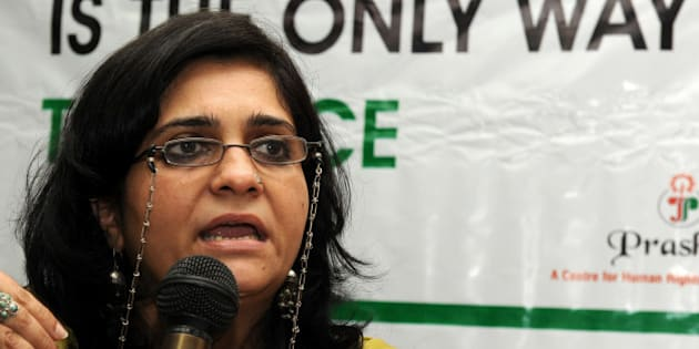 Secretary of The Citizens for Justice and Peace (CJP) Teesta Setalvad addresses media representatives during a press conference in Ahmedabad on August 14, 2010, held under the auspices of The Citizens for Justice and Peace (CJP) organisation. Sandhi spoke of the Gujarat riots in 2002 in the western Indian city which were sparked off by an incident on a train in the town of Godhra.  AFP PHOTO/Sam PANTHAKY (Photo credit should read SAM PANTHAKY/AFP/Getty Images)