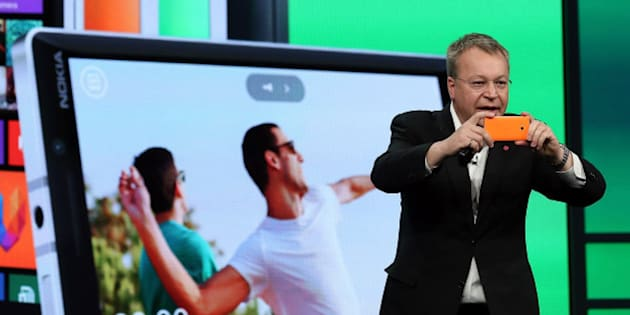 SAN FRANCISCO, CA - APRIL 02:  Nokia executive vice president Stephen Elop takes a picture using the new Nokia Lumia 930 smartphone as he speaks during a keynote address during the 2014 Microsoft Build developer conference on April 2, 2014 in San Francisco, California. The 2014 Microsoft Build developer conference runs through April 4.  (Photo by Justin Sullivan/Getty Images)
