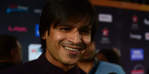 Presenter of IIFA Rocks and Nominee for Best performance in a Negative Role Bollywood actor Vivek Oberoi speaks to the media on the green carpet at the Tampa Convention Center ahead of IIFA Rocks on the second day of the 15th International Indian Film Academy (IIFA) Awards in Tampa, Florida, April 24, 2014. AFP PHOTO FREDERIC J. BROWN        (Photo credit should read FREDERIC J. BROWN/AFP/Getty Images)