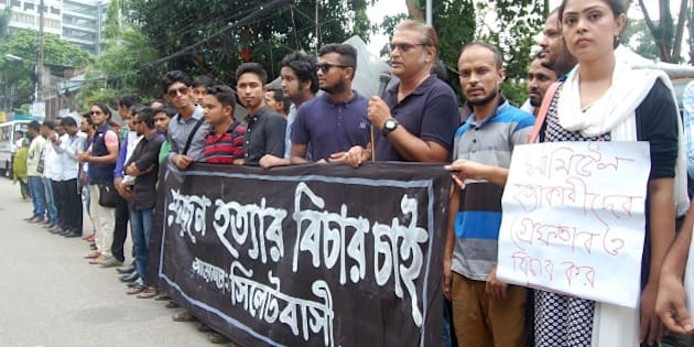 Bangladeshis protest against the beating death of a 13-year-old boy in Sylhet on July 13, 2015. Bangladesh police were hunting a group of attackers July 13 who lashed a 13-year-old boy to a stake and then beat him to death, filming the onslaught on a smart phone.  The 28-minute video, in which the boy is seen begging for water as he lay dying in the northeastern city of Sylhet, has sparked huge protests in Bangladesh since it went viral on social media over the weekend.  AFP PHOTO        (Photo credit should read STR/AFP/Getty Images)