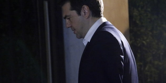 Greece's Prime Minister Alexis Tsipras leaves the Presidential Palace after his meeting with the Greek President Prokopis Pavlopoulos in Athens, Wednesday, July 8, 2015. Tsipras has stretched his EU partners' patience to the limit with months of missteps and contradictory moves and now, having just four days to save his country from ruin, is finding his list of allies is short. (AP Photo/Petros Karadjias)