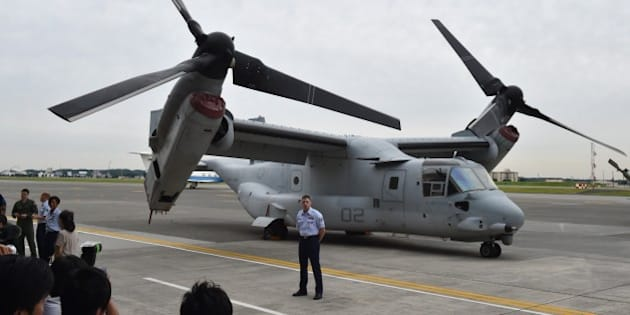 A US Marine Corps MV-22 Osprey is displayed in front of a hangar during a change of command ceremony at US Yokota Air Base in Tokyo on June 5, 2015. USAF Lieutenant General John Dolan, the new commander of US Forces Japan (USFJ), replaced outgoing commander Lt. Gen. Salvatore Angelella.     AFP PHOTO / KAZUHIRO NOGI        (Photo credit should read KAZUHIRO NOGI/AFP/Getty Images)