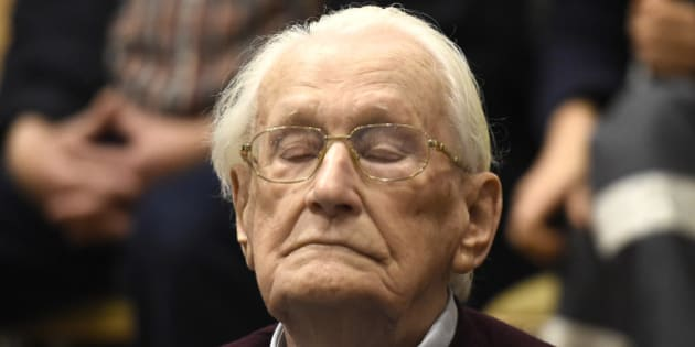 94-year-old former SS sergeant Oskar Groening listens to the verdict of his trial Wednesday, July 15, 2015 at a court in Lueneburg, northern Germany. Groening, who served at the Auschwitz death camp was convicted on 300,000 counts of accessory to murder and given a four-year sentence. (Tobias Schwarz/Pool Photo via AP)