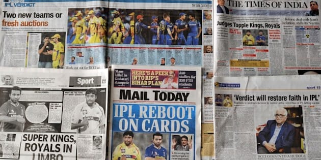 This photo illustration taken in New Delhi on July 15, 2015, shows Indian media coverage of the suspension of the Chennai Super Kings and Rajasthan Royals cricket teams from the Indian Premier League's next two editions after top officials were caught betting on matches involving their own teams.  India's cricketing fraternity July 15 welcomed the shock decision to ban two teams from the IPL as a long overdue opportunity for the game to clean up its scandal-sullied image.   AFP PHOTO        (Photo credit should read STR/AFP/Getty Images)