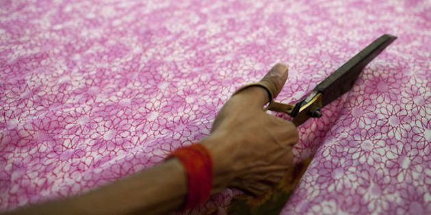 An Indian labourer cuts patterned fabric at the April Cornell clothing factory in Noida on the outskirts of New Delhi on October 16, 2012. The April Cornell company exports 50 percent of their clothing and linen production to the USA and Canada, and the rest to European Union countries. India's industrial output picked up pace in August, official data showed, growing 2.7 percent from the same month a year earlier in a better-than-expected but still muted performance.   AFP PHOTO/ Andrew Caballero-Reynolds        (Photo credit should read Andrew Caballero-Reynolds/AFP/Getty Images)