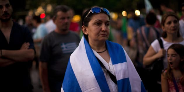 Demonstrators gather near the Greek Parliament during a rally against the government's agreement with its creditors in Athens, in central Athens, Tuesday, July 14, 2015. The eurozone's top official says it's not easy to find a way to get Greece a short-term cash infusion that will help it meet upcoming debt repayments. (AP Photo/Emilio Morenatti)