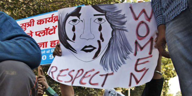 """FILE - In this Dec. 8, 2014 file photo, supporters of Aam Aadmi (Common Man) Party (AAP) hold placards during a protest after a woman was allegedly raped by a driver from ride-booking service Uber in New Delhi, India. Uber promises to focus on rider safety amid increasing concerns that its drivers are not adequately screened for past criminal convictions. In a blog post Wednesday, Dec. 17, 2014, Uber's head of global safety defended the company's safety record but also wrote that """"as we look to 2015, we will build new safety programs and intensify others.""""   (AP Photo/Tsering Topgyal, File)"""