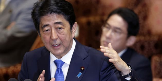 Japanese Prime Minister Shinzo Abe speaks during a parliament committee session regarding controversial bills on Japan's defense role overseas at the parliament in Tokyo,  Wednesday, July 15, 2015. (AP Photo/Shuji Kajiyama)