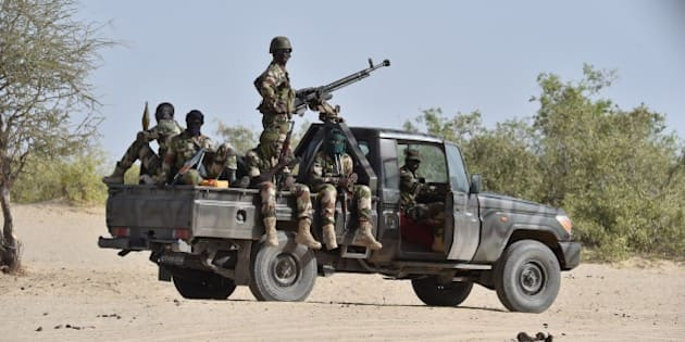 Nigerien soldiers  patrol in Bosso, near the Nigerian border, on May 25, 2015. Niger has extended for three months the state of emergency in its southeastern Diffa region where the army has been battling Boko Haram militants since February, authorities announced on May 27, 2015.  The operation, nicknamed Barkhane, which succedeed to Serval one, is taking place across Mauritania, Mali, Burkina Faso, Niger and Chad and involves a total 3,000 French troops.  AFP PHOTO / ISSOUF SANOGO        (Photo credit should read ISSOUF SANOGO/AFP/Getty Images)