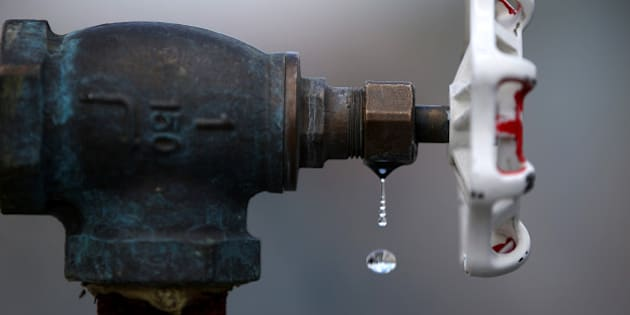 PLEASANTON, CA - APRIL 08:  Water drips from a faucet at the Dublin San Ramon Services District (DSRSD) residential recycled water fill station on April 8, 2015 in Pleasanton, California.  As California enters its fourth year of severe drought, the DSRSD is allowing residents to pick up free recycled water to be used to water trees, gardens, and lawns. Residents can California residents are facing a mandatory 25 percent reduction in water use.  (Photo by Justin Sullivan/Getty Images)