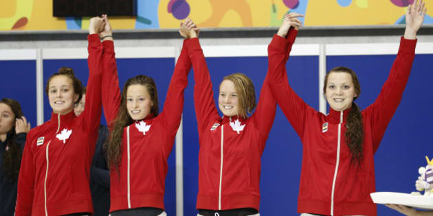 The Canada women's 4x200m freestyle relay team celebrate after winning the bronze medal in at the Pan Am Games, Thursday, July 16, 2015, in Toronto. (AP Photo/Julio Cortez)