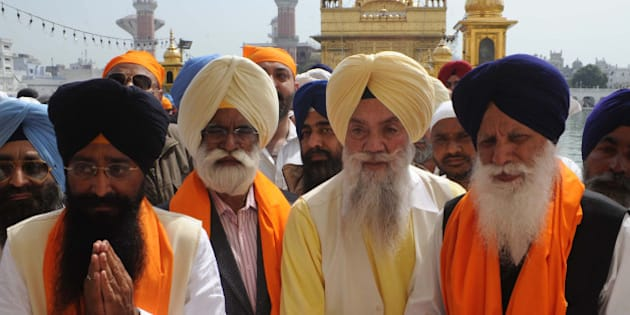 Punjab state Cabinet Ministers Sharanjit Singh Dhillon (L), Sarwan Singh Phillaur (2L) and Tota Singh (R) pay their respects at the Sikh Shrine in Amritsar on March 16, 2012. Punjab Chief Minister Parkash Singh Badal and his cabinet ministers visited the city after taking oath as chief minister for the fifth time during a swearing-in ceremony at Chappar Chiri in Mohali on March 14. AFP PHOTO/NARINDER NANU (Photo credit should read NARINDER NANU/AFP/Getty Images)