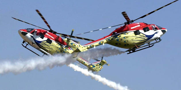 BANGALORE, INDIA:  Advanced Light Helicopters (ALH) of the Indian Air Force's Sarang aerobatics team perform during the inaugural function of the Aero India 2005 airshow at the Yelahanka Air Force Station on the outskirts of Bangalore, 09 February 2005. More than 200 foreign aviation firms from 31 countries are showcasing their products in India's hight tech capital at the five day-long Aero India, billed as the largest air show in South Asia. The United States, Britain, France, Russia, Israel, China and Malaysia are among the nations participating in the five day-long biennial show.   AFP PHOTO/INDRANIL MUKHERJEE  (Photo credit should read INDRANIL MUKHERJEE/AFP/Getty Images)