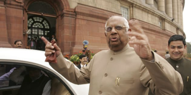 ** FILE ** In this Feb. 28, 2007 file photo, Indian Speaker of Lower House, Somnath Chatterjee gestures as he leaves the Parliament House in New Delhi, India. A day after Prime Minister Manmohan Singh won a confidence vote that paves the way for a landmark nuclear deal with the United States,the Communist Party of India (Marxist) kicked out Chatterjee, who defied the party's leadership and chaired the debate instead of giving up the speakership so he could vote as a regular member of parliament. (AP Photo/Gurinder Osan, File)