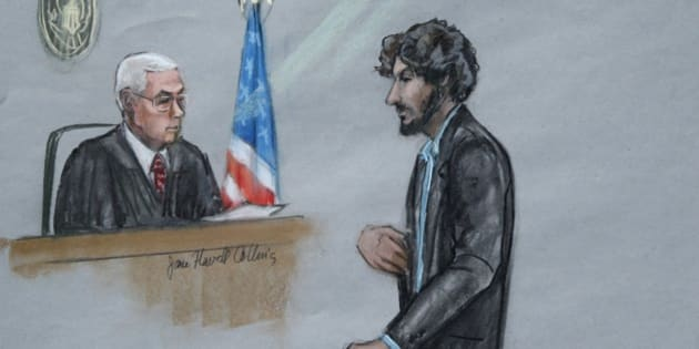 FILE - In this June 24, 2015, file courtroom sketch, Boston Marathon bomber Dzhokhar Tsarnaev, right, stands before U.S. District Judge George O'Toole Jr. as he addresses the court during his sentencing, in federal court in Boston. He is now detained in the highest-security prison in the U.S. Penitentiary in Florence, Colo., after being sentenced to death in June. (Jane Flavell Collins via AP, File)