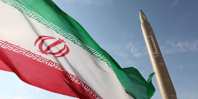 A picture taken on August 20, 2010 shows an Iranian flag fluttering at an undisclosed location in the Islamic republic next to a surface-to-surface Qiam-1 (Rising) missile which was test fired a day before Iran was due to launch its Russian-built first nuclear power plant. Iranian Defence Minister Ahmad Vahidi said the missile was entirely designed and built domestically and powered by liquid fuel.  AFP PHOTO/VAHID REZA ALAEI (Photo credit should read VAHID REZA ALAEI/AFP/Getty Images)
