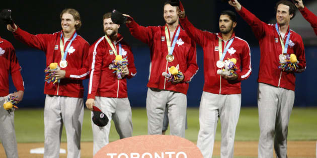 Canada baseball athletes wear their gold medals awarded to them during the baseball tournament medal ceremony at the Pan Am Games, Sunday, July 19, 2015, in Ajax, Ontario. (AP Photo/Julio Cortez)