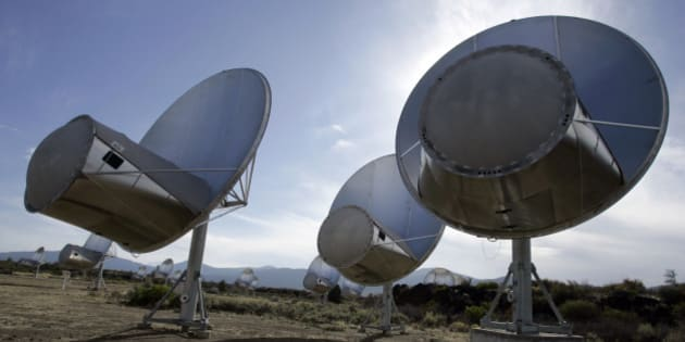 FILE -  In this Oct. 9, 2007 file photo, radio telescopes of the Allen Telescope Array are seen in Hat Creek, Calif. Astronomers at the SETI Institute in Northern California say a steep drop in state and federal funds has forced the shutdown of a key program to search for extraterrestrial life. Dozens of radio dishes that make up the Allen Telescope Array in the mountains of far Northern California have scanned deep space since 2007 for alien signals. (AP Photo/Ben Margot, File)
