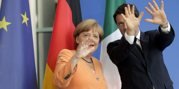 German Chancellor Angela Merkel, left, and the Prime Minster of Italy, Matteo  Renzi, right, gesture after a press conference as part of a meeting at the chancellery in Berlin, Germany, Wednesday, July 1, 2015. (AP Photo/Michael Sohn)