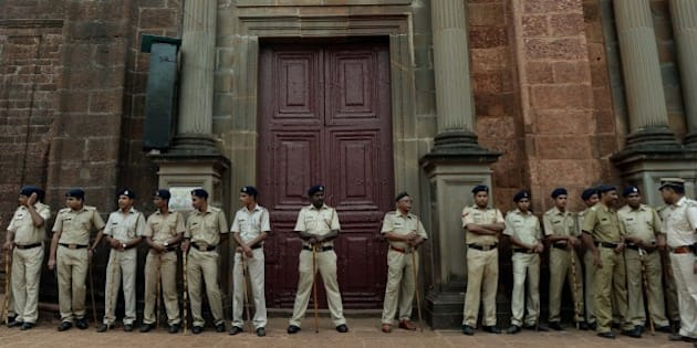 Indian policemen stand guard outside the Basilica of Bom Jesus before the start of a procession carrying the remains of St. Francis Xavier in Goa on November 22, 2014. The 17th exposition of the body of St Francis Xavier will be held from November 22 to January 4, 2015 in Goa, for veneration by pilgrims.  AFP PHOTO/ PUNIT PARANJPE        (Photo credit should read PUNIT PARANJPE/AFP/Getty Images)